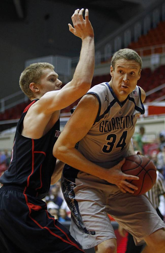 Northeastern forward Scott Eatherton, left, pressures Georgetown forward Nate Lubick during a NCAA college basketball game in San Juan, Puerto Rico, Thursday, Nov. 21, 2013