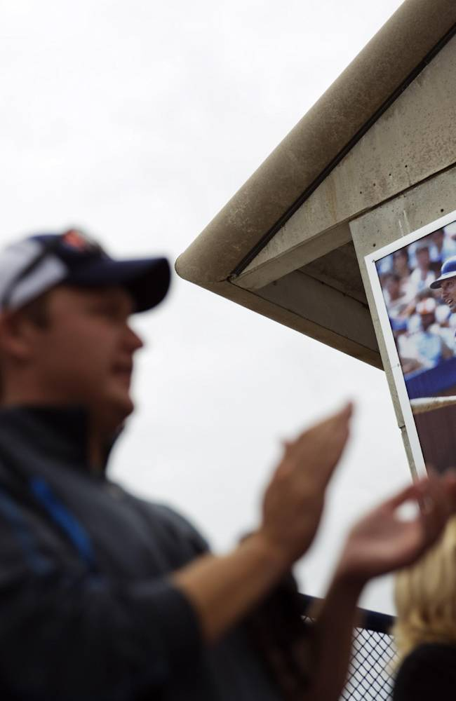 An image of former New York Mets catcher Gary Carter hangs in Tradition Field as spectators cheer while watching an exhibition spring training baseball game between the Mets and the Washington Nationals, Thursday, March 27, 2014, in Port St. Lucie, Fla