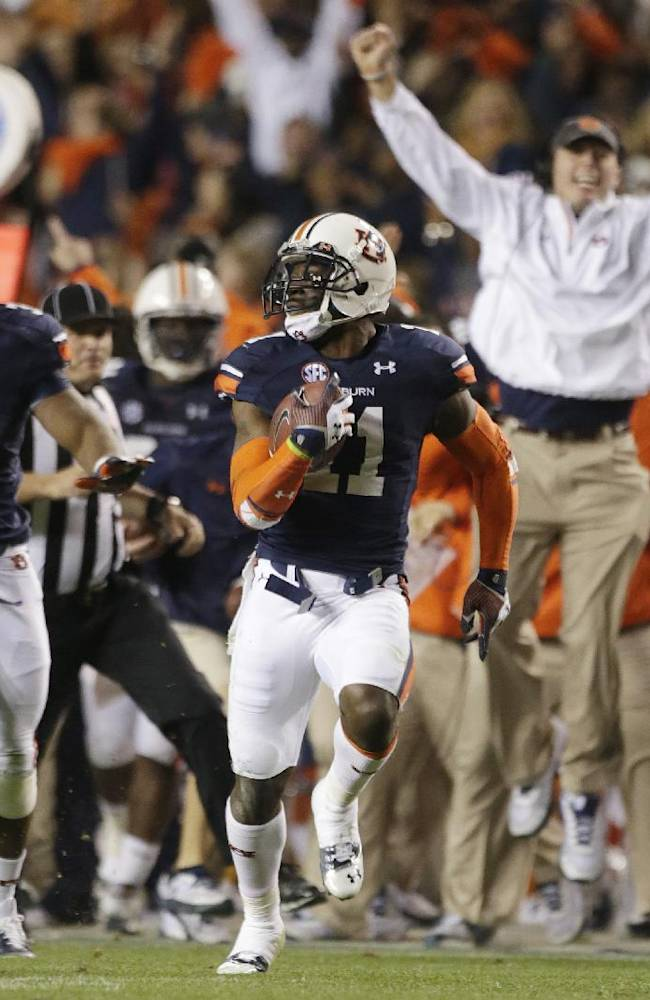 In this Nov. 30, 2013 file photo, Auburn cornerback Chris Davis (11) returns a field goal attempt 109-yards to score the winning touchdown over Alabama during the second half of an NCAA college football game in Auburn, Ala. Davis's 109-yard return of a missed field goal to beat Alabama was one of the Iron Bowl's and the season's most memorable plays