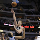 Brooklyn Nets forward Mason Plumlee (1) shoots over Dallas Mavericks guard Devin Harris (20) during the first half of an NBA basketball game Sunday, March 23, 2014, in Dallas The Associated Press