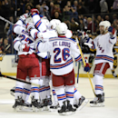 New York Rangers left wing Tanner Glass (15) skates in to celebrate defenseman Kevin Klein's (8) goal in overtime against the Pittsburgh Penguins with teammates in an NHL hockey game at Madison Square Garden on Monday, Dec. 8, 2014, in New York The Associ