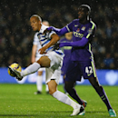 QPR's Bobby Zamora, left, vies for the ball with Manchester City's Yaya Toure during the English Premier League soccer match between Queens Park Rangers and Manchester City at Loftus Road stadium in London, Saturday, Nov. 8, 2014