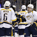 Nashville Predators center Filip Forsberg (9) celebrates his goal against the Colorado Avalanche with teammate Shea Weber (6) during the first period of an NHL hockey game Tuesday, Dec. 9, 2014, in Denver The Associated Press