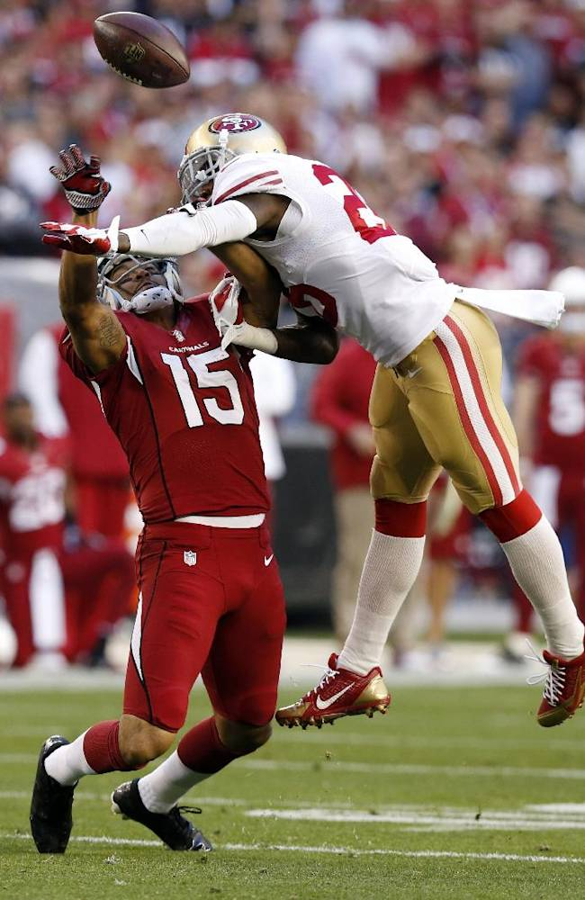 Arizona Cardinals wide receiver Michael Floyd (15) has his pass broken up by San Francisco 49ers cornerback Tramaine Brock during the second half of an NFL football game, Sunday, Dec. 29, 2013, in Glendale, Ariz. The San Francisco 49ers won 23-20