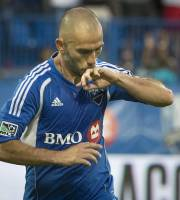 Montreal Impact's Marco Di Vaio kisses his wedding ring after scoring against D.C. United during the first half of an MLS soccer game Saturday, Aug. 17, 2013, in Montreal. (AP Photo/The Canadian Press, Peter McCabe)