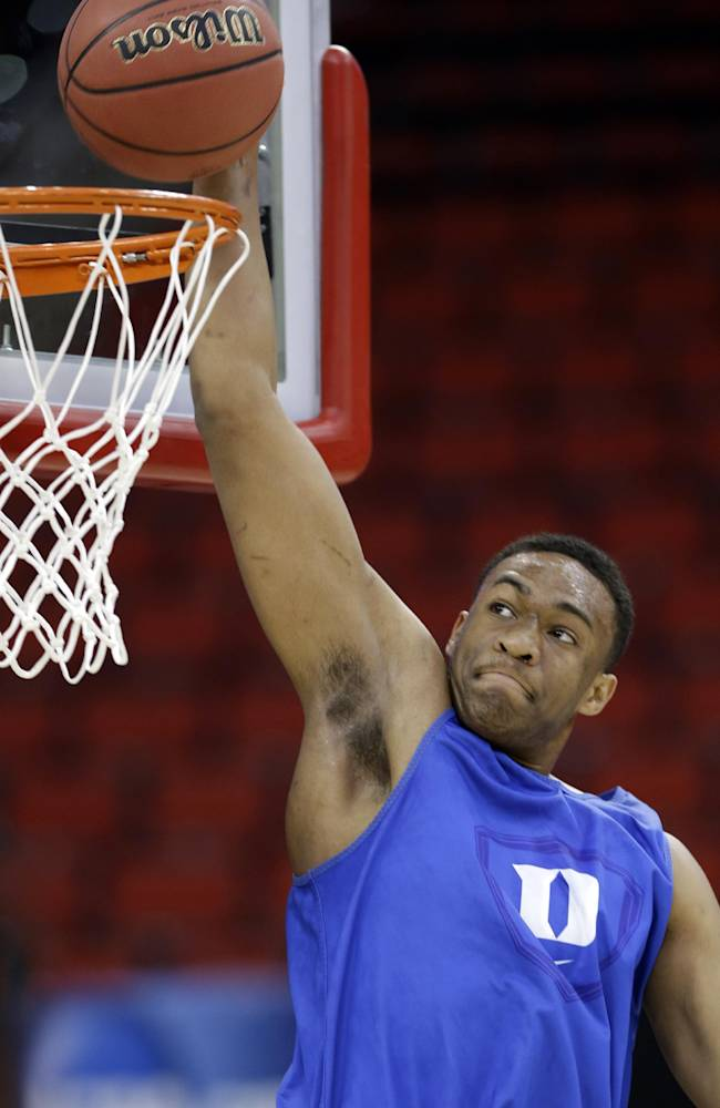 Duke's Jabari Parker goes up to dunk during practice at the NCAA college basketball tournament in Raleigh, N.C., Thursday, March 20, 2014. Duke plays Mercer in a second-round game on Friday