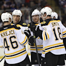 Boston Bruins center David Krejci (46), eft wing Milan Lucic (17), defenseman Kevan Miller (86), defenseman Torey Krug and right wing Reilly Smith (18) celebrate Krug's goal during the third period of an NHL hockey game against the New York Islanders at