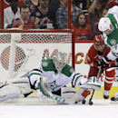 Dallas Stars goalie Kari Lehtonen, of Finland, and Stars' Jamie Benn (14) defend the goal against Carolina Hurricanes' Nathan Gerbe, middle, during the first period of an NHL hockey game in Raleigh, N.C., Thursday, April 3, 2014 The Associated Press