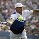 John Isner returns a shot against Philipp Kohlschreiber, of Germany, during the third round of the 2013 U.S. Open tennis tournament, Saturday, Aug. 31, 2013, in New York. (AP Photo/David Goldman)