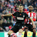 Sunderland's Jermain Defoe, right, vies for the ball with Fulham's captain Nikolay Bodurov, left, during the English FA Cup fourth round soccer match between Sunderland and Fulham at the Stadium of Light, Sunderland, England, Saturday, Jan. 24, 2015