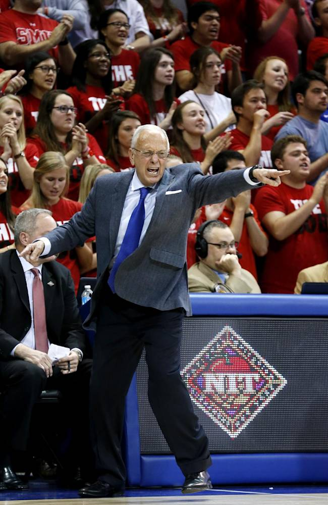 SMU head coach Larry Brown tries to get his players attention during the second half of an NCAA college basketball game against LSU in the second round of the NIT Monday, March 24, 2014, in Dallas, Texas