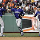 Colorado Rockies' Troy Tulowitzki (2), Carlos Gonzalez, center, and Brandon Barnes (1) celebrate a 1-0 win over the San Francisco Giants in a baseball game on Saturday, April 12, 2014, in San Francisco The Associated Press