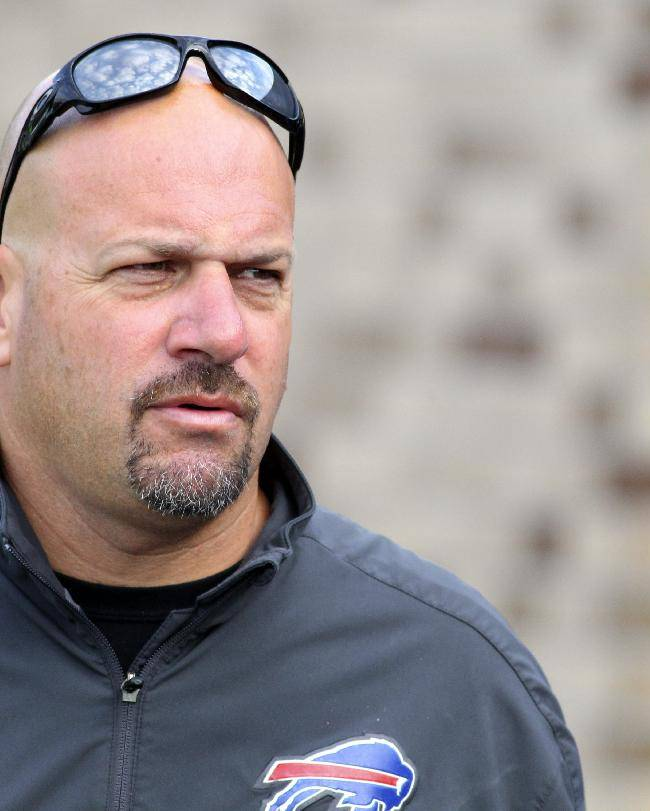 In this July 31, 2013, file photo, Buffalo Bills defensive coordinator Mike Pettine walks to the field during NFL football training camp in Pittsford, N.Y. in his new role as the Bills defensive coordinator,e Pettine is getting an opportunity to face his mentor, Rex Ryan on Sunday, when Buffalo travels to play the New York Jets. Pettine spent the previous four seasons in the same role with the Jets
