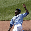 Kansas City Royals' Lorenzo Cain slides home to score the game-winning run on a double by Eric Hosmer during the ninth inning of a baseball game against the Minnesota Twins Sunday, July 5, 2015, in Kansas City, Mo. The Royals won the game 3-2. (AP Photo/Charlie Riedel)