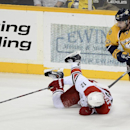 Nashville Predators forward Mike Fisher, right, shoves Carolina Hurricanes center Eric Staal, left, to the ice while trying to get control of the puck in the third period of an NHL hockey game on Thursday, Dec. 5, 2013, in Nashville, Tenn. The Hurricanes