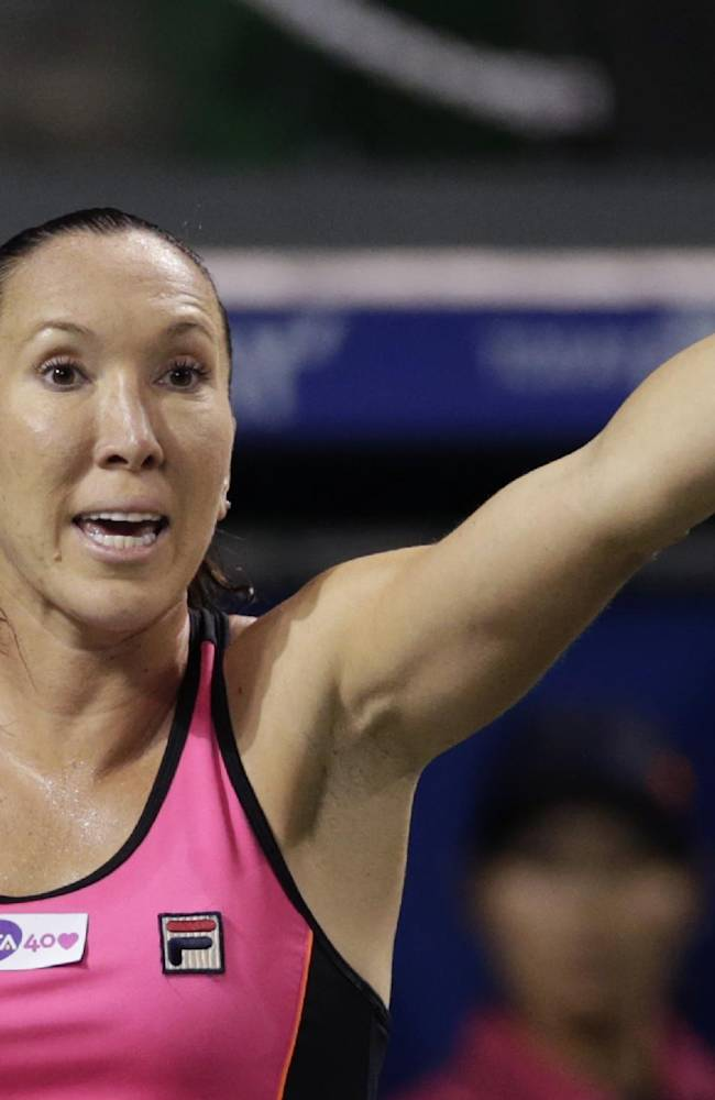 Serbia's Jelena Jankovic reacts after losing a point against Eugenie Bouchard of Canada during their third round match of the Pan Pacific Open tennis tournament in Tokyo, Wednesday, Sept. 25, 2013