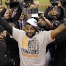 In this Oct. 29, 2014, file photo, San Francisco Giants' Pablo Sandoval celebrates after Game 7 of baseball's World Series against the Kansas City Royals in Kansas City, Mo. The Giants won 3-2 to win the series. Giants assistant general manager Bobby Eva