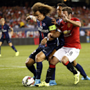 IMAGE DISTRIBUTED FOR INTERNATIONAL CHAMPIONS CUP - Paris Saint-Gemain's Ezequiel Lavezzi, left, battles for the ball with Manchester United's Juan Mata during the International Champions Cup Play on Wednesday, July 29, 2015 in Chicago. (AJ Mast /
