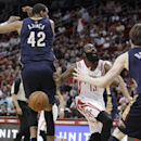 Houston Rockets guard James Harden (13) has the ball stripped away by New Orleans Pelicans center Alexis Ajinca (42) during the second quarter of an NBA basketball game, Saturday, April 12, 2014, in Houston. (AP Photo/Patric Schneider)