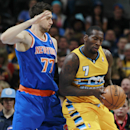 New York Knicks forward Andrea Bargnani, left, of Italy, covers Denver Nuggets forward J.J. Hickson who pulls in a loose ball in the first quarter of an NBA basketball game in Denver, Friday, Nov. 29, 2013 The Associated Press