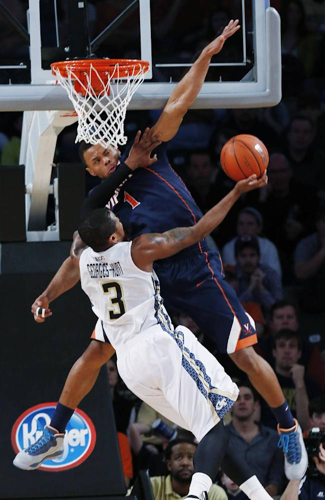 Georgia Tech forward Marcus Georges-Hunt (3) has his shot blocked by Virginia guard Justin Anderson (1) in the second half of an NCAA college basketball game Saturday, Feb. 8, 2014, in Atlanta.  Virginia won 64-45