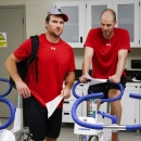 Calgary Flames' Matt Stajan, right, and Dennis Wideman chat as they during the opening day NHL hockey training camp in Calgary, Alberta, Thursday, Sept. 18, 2014 The Associated Press