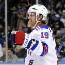 New York Rangers center Brad Richards celebrates his second of three goals against the Buffalo Sabres during the second period of an NHL hockey game in Buffalo, N.Y., Friday, April 19, 2013. New York won 8-4. (AP Photo/Gary Wiepert)