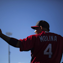St. Louis Cardinals' Yadier Molina stands in the dugout during the eighth inning of an exhibition spring training baseball game against the Washington Nationals, Saturday, March 8, 2014, in Jupiter, Fla The Associated Press