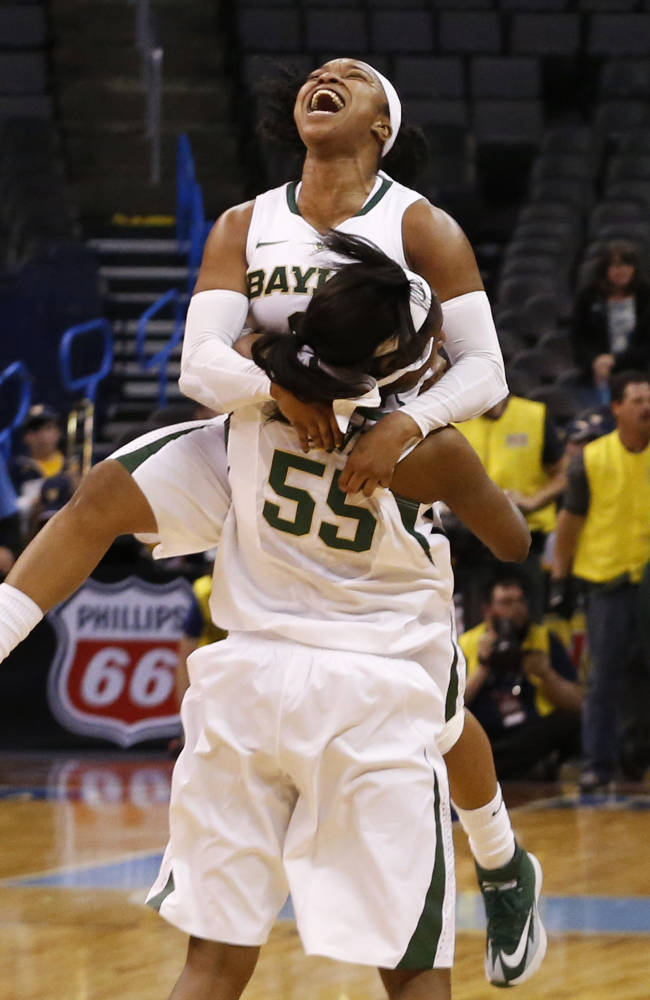 Baylor guard Odyssey Sims (0) celebrates with point Khadijiah Cave (55) following an NCAA college basketball game in the finals of the Big 12 Conference women's college tournament in Oklahoma City, Monday, March 10, 2014. Baylor won 74-71