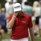 Keegan Bradley walks off the 11th green during the final round of the Byron Nelson golf tournament on Sunday, May 19, 2013, in Irving, Texas. Bradley, who bogeyed the hole, finished two strokes behind tournament champion Sang-Moon Bae. (AP Photo/Tony Gutierrez)