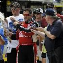 Tony Stewart signs autographs as he walks to the garage before practice for Sunday's NASCAR Sprint Cup Series auto race at Atlanta Motor Speedway, Saturday, Sept. 1, 2012, in Hampton, Ga. (AP Photo/Rainier Ehrhardt)