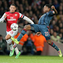 Arsenal's Alex Oxlade-Chamberlain, left, and Bayern's David Alaba challenge for the ball during a Champions League, round of 16, first leg soccer match between Arsenal and Bayern Munich at the Emirates stadium in London, Wednesday, Feb. 19, 2014