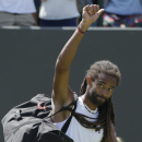 Dustin Brown of Germany leaves the court after losing to Viktor Troicki of Serbia in their singles match at the All England Lawn Tennis Championships in Wimbledon, London, Saturday July 4, 2015. Troicki won the match 6-4, 7-6, 4-6, 6-3. (AP Photo/Pavel Golovkin)