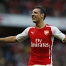 Arsenal's Santi Cazorla reacts in frustration at the slow pace of a throw in, during the English Premier League soccer match between Arsenal and Hull City at the Emirates stadium in London Saturday, Oct.18, 2014