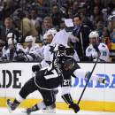San Jose Sharks left wing Raffi Torres, top, collides with Los Angeles Kings defenseman Alec Martinez during the first period in Game 3 of an NHL hockey first-round playoff series , Tuesday, April 22, 2014, in Los Angeles The Associated Press