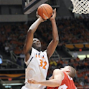 Illinois' forward/center Nnanna Egwu (32) shoots over Wisconsin's forward/center Jared Berggren (40) in the first half of an NCAA college basketball game at Assembly Hall in Champaign, Ill., Sunday, Feb. 3, 2013. (AP Photo/Robin Scholz)