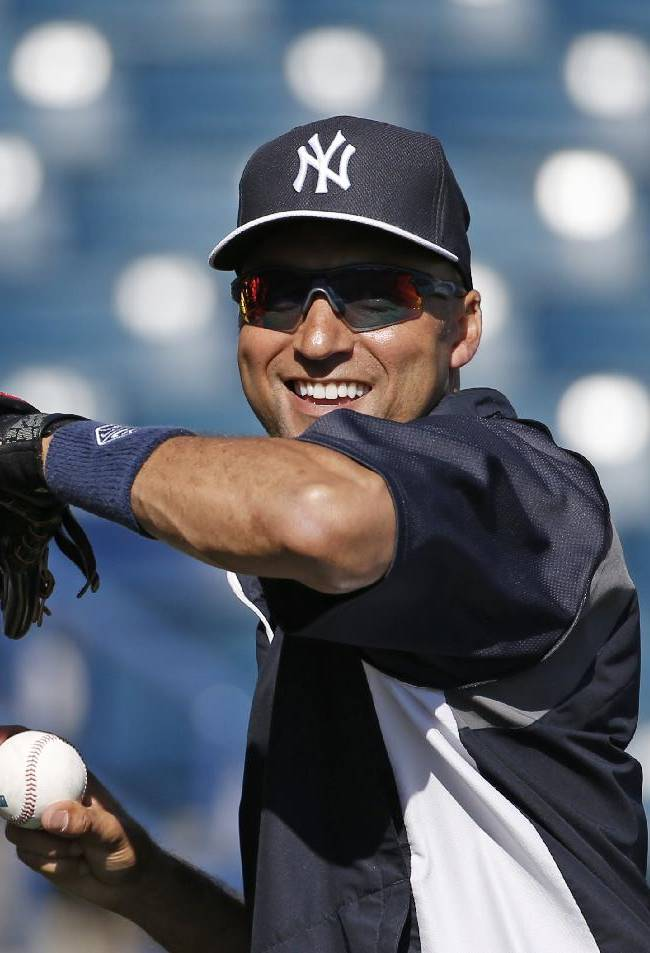 New York Yankees shortstop Derek Jeter throws long toss on the field before a spring exhibition baseball game against the Boston Red Sox in Tampa, Fla., Tuesday, March 18, 2014