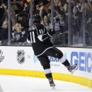 Los Angeles Kings center Anze Kopitar (11) reacts after scoring against the San Jose Sharks in the second period during Game