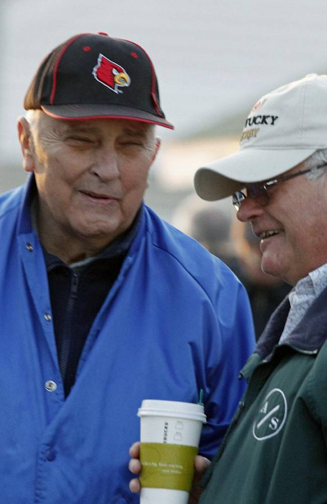 Thoroughbred trainers Forrest Kalin, left, and Kentucky Derby winning trainer Art Sherman, right, laugh together outside Barn 20, at Churchill Downs in Louisville, Ky., Sunday, May 4, 2014