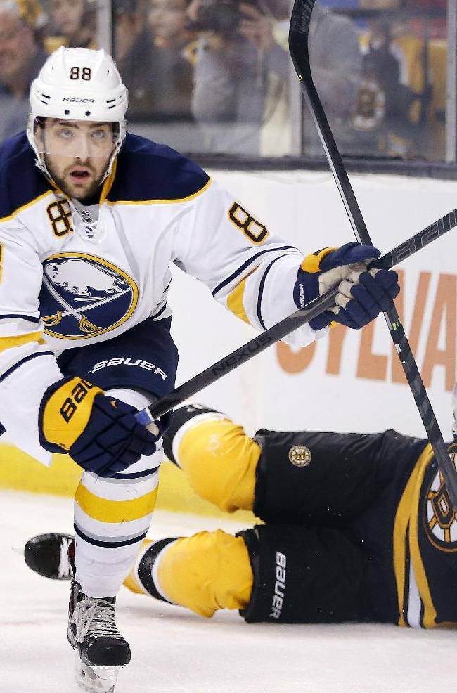 Buffalo Sabres' Cory Conacher (88) skates away after checking Boston Bruins' Johnny Boychuk (55) into the boards during the first period of an NHL hockey game in Boston, Saturday, April 12, 2014