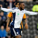 West Bromwich's Victor Anichebe appeals for a penalty during the English Premier League soccer match against Hull City at the KC Stadium, Hull, England, Saturday Dec. 6, 2014