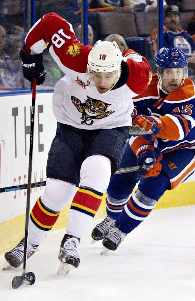 Florida Panthers' Shawn Matthias (18) is chased by Edmonton Oilers' Nick Schultz (15) during first period NHL hockey action in Edmonton, Alberta, on Thursday Nov. 21, 2013