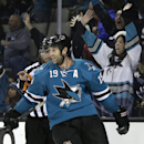 San Jose Sharks' Joe Thornton celebrates after scoring an empty net goal against the Nashville Predators during the third period of an NHL hockey game Saturday, Dec. 13, 2014, in San Jose, Calif The Associated Press