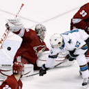 Phoenix Coyotes' Mark Visentin, left, makes a stick save on a shot by San Jose Sharks' Tommy Wingels (57) as Coyotes' Brandon Gormley (33) defends and Chris Summers (20) watches during the third period of an NHL hockey game Saturday, April 12, 2014, in Gl