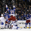 New York Rangers defenseman Ryan McDonagh (27) leaps after New York Rangers left wing Chris Kreider scored to tie the game with less than a minute remaining during the third period of Game 3 of the NHL hockey Stanley Cup playoffs Eastern Conference finals