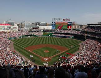 President Barack Obama delivers the ceremonial first pitch during opening day ceremonies for a baseball game between the Philadelphia Phillies and Washington Nationals, Monday, April 5, 2010, at Nationals Park in Washington. (AP Photo/Pablo Martinez Monsivais)