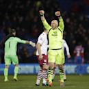 Aston Villa's U.S. goalkeeper Brad Guzan celebrates their 1-0 victory towards his side's fans after the English Premier League soccer match between Crystal Palace and Aston Villa at Selhurst Park stadium in London, Tuesday, Dec. 2, 2014