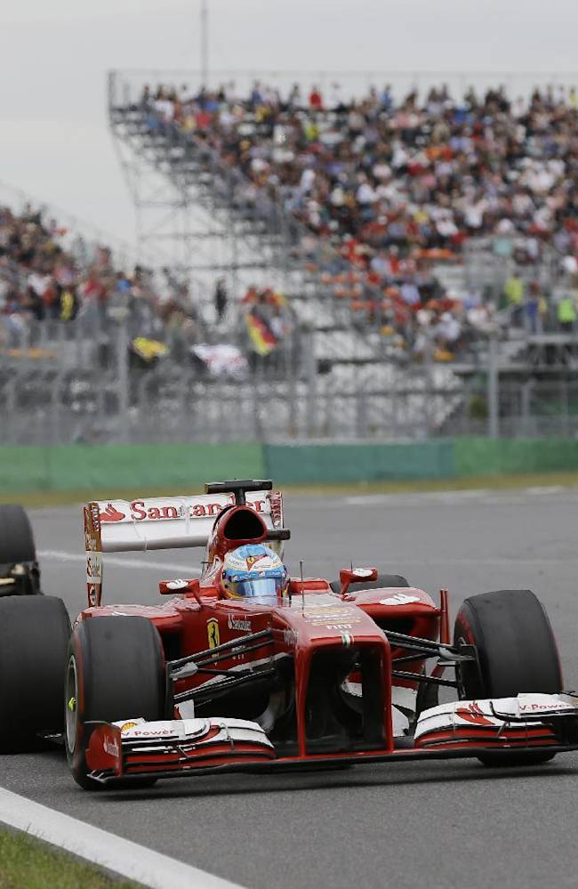 Ferrari driver Fernando Alonso of Spain steers his car during the Korean Formula One Grand Prix at the Korean International Circuit in Yeongam, South Korea, Sunday, Oct. 6, 2013
