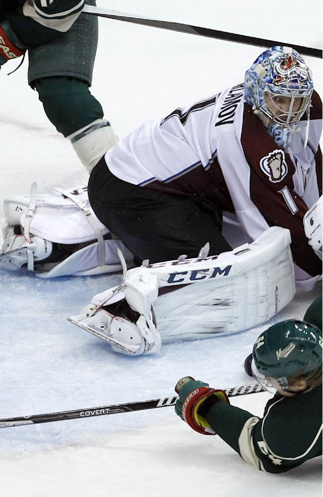 Minnesota Wild center Mikael Granlund (64), of Finland, shoots the puck around Colorado Avalanche defenseman Erik Johnson (6) and  Avalanche goalie Semyon Varlamov (1), of Russia, to score the game-winning goal during overtime of Game 3 of an NHL hockey first-round playoff series in St. Paul, Minn., Monday, April 21, 2014. The Wild won 1-0 in overtime