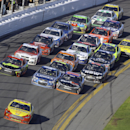 Joey Logano (22) leads the field during the Daytona 500 NASCAR Sprint Cup series auto race at Daytona International Speedway in Daytona Beach, Fla., Sunday, Feb. 22, 2015. (AP Photo/David Graham)